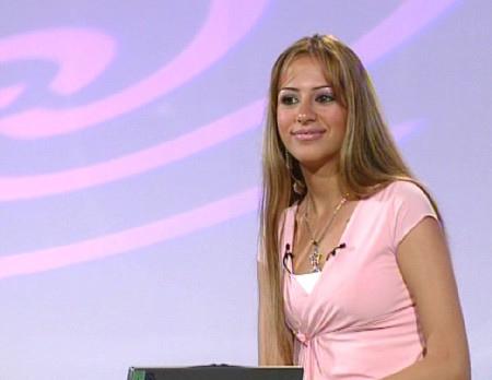 Familiar formula: pretty, Westernized girls.  Arab Iraqi TV Presenter Rosil Al Azawi.