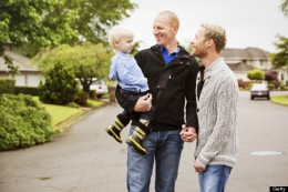 Not a family. Queer couple with adopted blond boy.