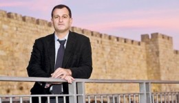A photo accompanying the story of Louis Aliot's visit to Israel in Ha'Aretz. Notice that the castle wall in the background has battlements, the Wailing Wall does not. Also, this castle has uniform stone size while Wailing Wall has large stones in the bottom and middle with smaller stones near the top.[ http://www.haaretz.com/print-edition/news/french-national-front-heads-to-israel-to-stump-for-support-ahead-of-election-1.401091]