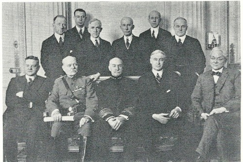 """ECONOMIC section of the American delegation to the Paris Peace Conference: Bernard Baruch is seated second from the right. Standing third from the right is """"Colonel"""" Edward Mandel House."""