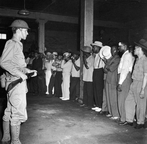 A member of the National Guard and black men stand off during the 1943 Detroit Race Riots.