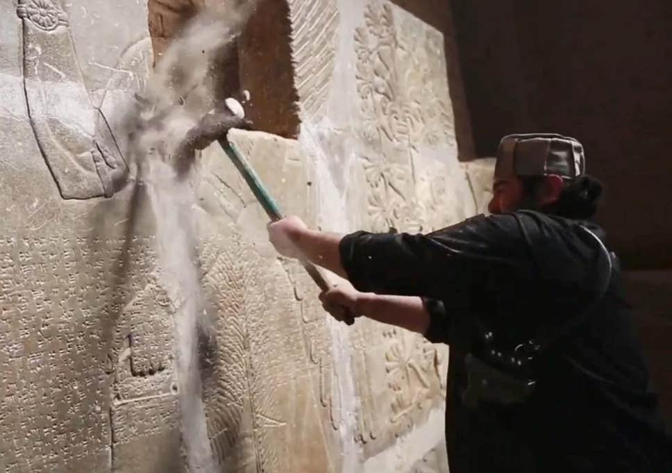 ISIS militant destroys Assyrian sculpture, Mosul, Iraq