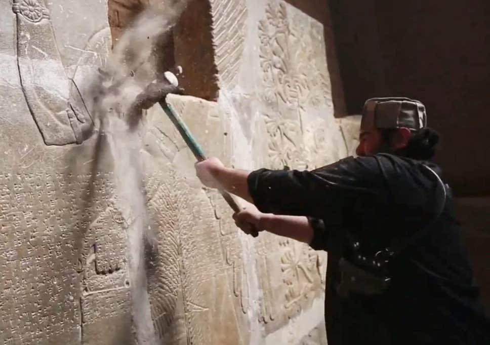 ISIS militant destroys Assyrian sculpture, Mosul, Iraq